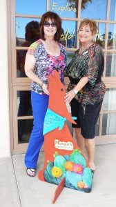Vicky Walter, LEFT, and Cheri Thompson at the Mesquite Chamber of Commerce show off Jody the Coyote, painted by Diana Coonradt. Courtesy Photo