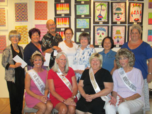 MLN-Moniesmay22-14: Standing left to right: Jean Watkins, Darlene Carpenter, Milt Riley, Carole Hanley, Karen Taylor, Linda Muse and Mandy Meyer. Seated left to right: Donna Watson, Terry Blackburn, Donna Hendrickson and Jo Mollerup. Photo by Kimberly Cazier.