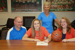 Abbie Barnard signing her letter of intent in front of (left to right) dad Tim, Abbie, mom Cindy and Coach Chimane Creer in back. Photo by Lou Martin