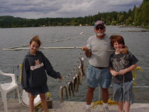 Writer Lou and his grandkids Emily and Jimbo with a mess of fish at Waitts Lake