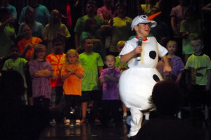 Parker Holt portrays the character Olaf from Disney's Frozen in Mesquite Kids on Stage's 2014 Disney Review.
