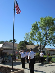 With the flag hoisted to the top, the Pledge of Allegiance was recited by attendees. Photo by Stephanie Frehner.