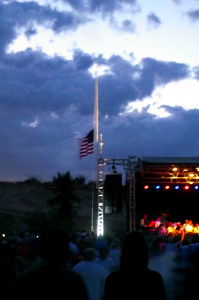 Mayor Al Litman presents and raises The American flag as the Nevada Pops plays the National Anthem during the Rockets over the Red Mesa, July 4th celebration at the Eureka Casino. Photo by Teri Nehrenz.