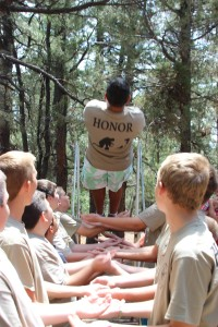 The Trust Fall, a Scout must trust his fellow Scouts to catch him as he falls off backwards from a platform.
