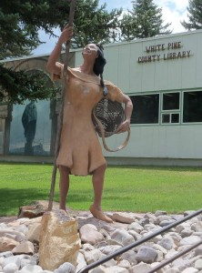 Shoshone woman gathering pinenuts statute in downtown Ely, Nevada - July 2014