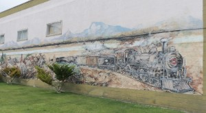 Downtown Ely public mural with steam locomotive and cowboys, Ely, Nevada - July 2014