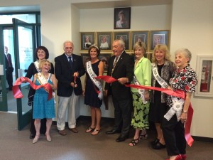 """On Tuesday, August 12, 2014, Ms. Senior Mesquite 2014, Donna Watson was joined by past queens, Jean Watkins, Claudia Nicholas, Mary Jane Vandeweghe, Margaret Parrott, Nila Lilienthal, Mayor Al Litman and Councilman Geno Withelder to dedicate the Queens' portrait wall at Mesquite City Hall. The Ms. Senior Mesquite pageant will be celebrating its tenth year in 2015. """"We are excited to welcome back the Ms. Senior Mesquite portraits,"""" Mayor Litman said. Photo courtesy of Delaney Studio."""
