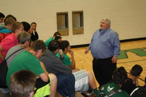 New Bulldog football coach Yori Ludvigson speaks to this year's football players during an introduction meeting at the high school gym in April. File Photo.