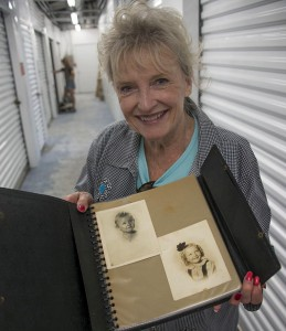 Karolyn Grimes today with album of childhood photos.