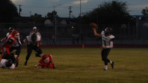 Bulldog quarterback Jaron Linge #3 attempts a pass against Western Friday night. Linge ran for two touchdowns to lead the Dawgs victory, Photo by Kirk Kern.