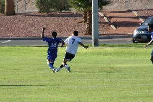 Bulldog Moise Medina #7 beats a Jaguar defender to score one of his 5 goals in a Dawg 6-3 defeat of Desert Pines. Photo by Lou Martin.