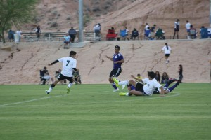 Photo by Lou Martin. Bulldog striker Moise Medina # 7 moves in to stop off a Spring Creek attack. Moise had the hat trick with three goals for the match.