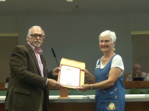Mayor Al Litman presents GMAF President Maggie Calhoun with the Council's proclamation designating October as Arts Month. Photo by Stephanie Frehner.