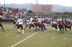 Bulldog runner Junior Paongo slips through the Crusader defense for a nice gain Friday in Las Vegas.