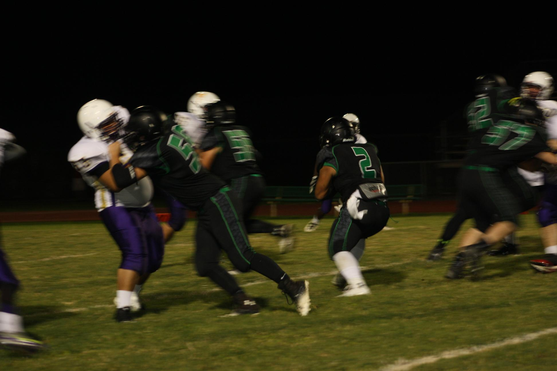 Paongo honors father with 4 T.D.'s in win over Miners 54-18