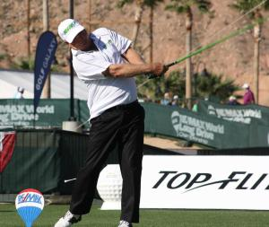 Masters Division Champ Rick Scott completes his winning swing. Photo by Lou Martin