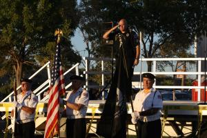 MPD Officer R. Stepp leads the throng in our Pledge of Allegiance prior to the events activities. Photo by Lou Martin