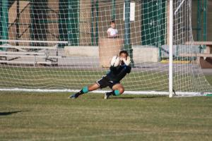 Bulldog Goalkeeper Domingo Ramirez stops a Dragon shot during the Bulldogs 3-1 win. Photo by Lou Martin.