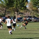 Roadrunners score early to defeat Bulldog soccer gals 1-0; Boys lose 3-1