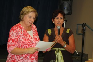 VVES Principal Cathy Davis, right,  presents a thank you award to Eureka Resort representative Gerri Chasko for their generous contribution to the 'Mesquite Reads' program. Photo by Lou Martin.