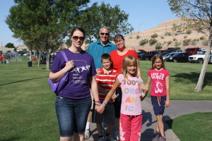 Mesquite Mental Health member Marie Stokey (left) walks with her parents Lee and Julie Foster and the Foster children Nate, Kate and Camille. Photo by Lou Martin.