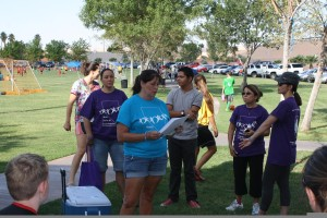 Pam Bruehl of the Mesquite Behavioral Health Center reads various letters from dignitaries regarding the event prior to the 'Walk' on Saturday morning. Photo by Lou Martin.