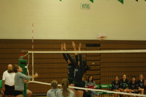 Bulldogs Kaydee Bingham and Lexi Thompson go high on an attempted kill by the Eagles. Thompson had 7 kills for the Dawgs. Photo by Lou Martin.