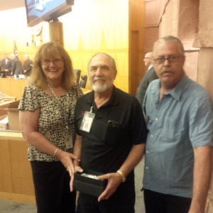RTC gathered on Oct. 9 to recognize one of Mesquite's drivers at their meeting. From left to right is Deb Dauenhauer, Executive Director, Bob Peterson and Mike Jackson, Assistant Executive Director. Submitted photo.