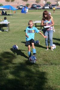 Luke Olsen, 8, with Elk member Joyce Dalton keeping score.
