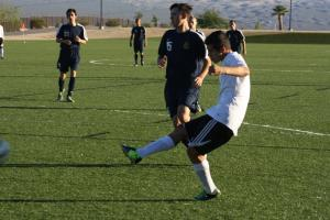 Moises Medina finishes off a goal kick one minute into the match on a pass from his brother Gabe Medina for the score. Photo by Lou Martin.