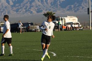 Gabby Medina #8 scores goal as Moises Medina #7 looks on. Photo by Lou Martin