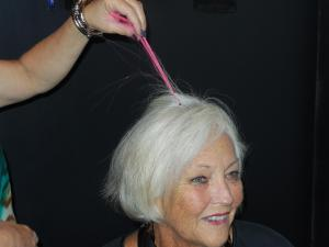 Carolee Seal tries a pink hair accent.