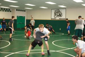 Bulldog grapplers work out under the watchful eyes of Coach Skylar Woods during recent tryouts. Photo by Lou Martin