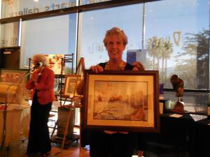 Sandy McConnell was pleased winner of watercolor painting by Gayle Pfeiffer