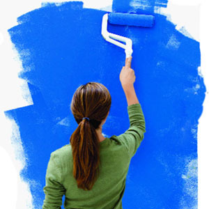 girl back paints blue wall