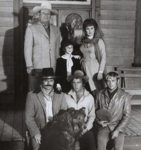 1. Cast of Big Jake. John Wayne and Maureeen O'Hara in back_ Patrick Wayne (L) and Chris Mitchum in front