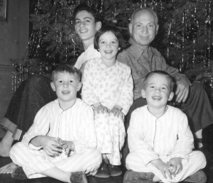 1. Christmas with Harpo. Bill is sitting next to Harpo, Minnie in the middle, Alex on the bottom left and Jimmy on the bottom right. (Photo provided by Bill Marx)