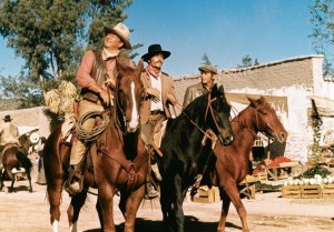 1. John Wayne, Patrick Wayne and Chris Mitchum in Big Jake.