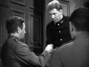 Screen shot of Richard Erdman beginning his film career by delivering a telegram to  Claude Rains in Mr. Skeffinton (1944) - Warner Bros.