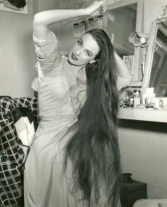 Early photo of Patricia Morison showing off her famous long, flowing dark hair