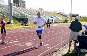 Michael Olson a Mesquite snow bird from Spanish Forks Utah wins the 5000 meter race. Photo by Burton Weast