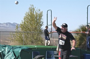 Archie Widener of Mesquite throws the shot put.  Widener is a member of the Mesquite Geezer's who sent over 15 volunteers to the games. Photo by Burton Weast