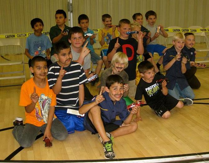 Spanish Branch and Mesquite 4th Ward boys with their cars.