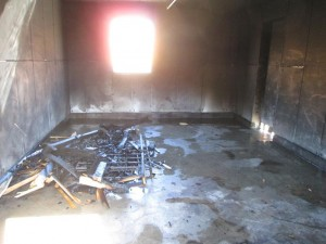 With this controlled event, the interior of the garage was empty, with the exception of the fuels used for the demonstration. In most cases, the garage houses a vehicle, gasoline tanks and other flammable liquids and materials that could explode due to the heat and cause further damage and possible injuries. Photo by Stephanie Frehner.