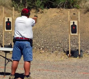 Mesquite Senior Games first time competitor, Bruce Landvik, shoots for the gold in the 2015 competition.  Photo by Teri Nehrenz