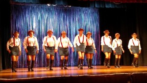 Inspired by their cruise to Alaska in May 2014, the 12 dancers performed their new number North to Alaska with suspenders bought from the Red Dog Saloon in Juneau. Photo by Stephanie Frehner.