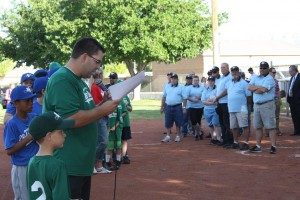 Little League president and emcee Dan Wright introduces dignitaries and VVLL board members Monday night at the VVLL season opener. Photo by Lou Martin