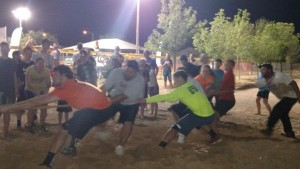 The Mesquite Recreation Center's Director, Nick Montoya, Center in white, and his staff went up against Councilwoman Cindi Delaney's team of City of Mesquite Staff in one of the final matches of the night. Needless to say, this was the final dry photo of Montoya and his team. Photo by Stephanie Frehner.