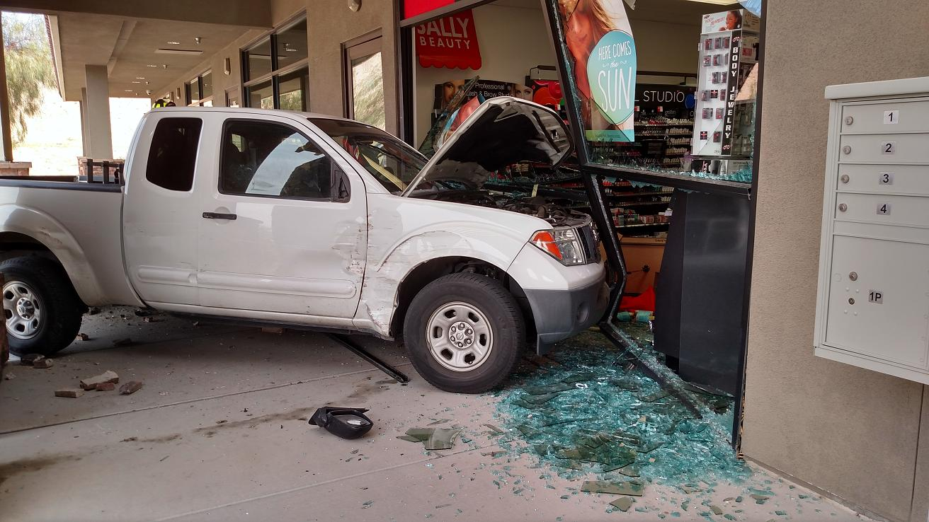 Crash leaves gaping hole in local store