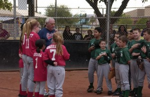 City Councilman assisted by ball players leads the Pledge of Allegiance. Photo by Burton Weast.